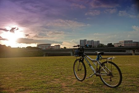 bicycle and sunset in the towns photo