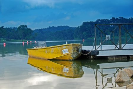 reservoirs: yellow boat in the reservoirs Stock Photo
