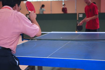 man playing table tennis in the school