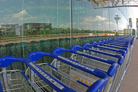 conveyor rail: trolley and tinted glass at the airport