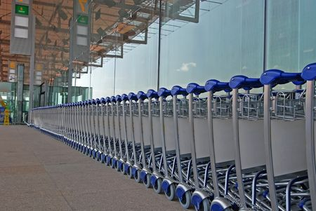 conveyor rail: trolley, and tinted glass at the airport