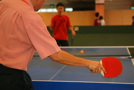 people playing table tennisl in the sport hall photo
