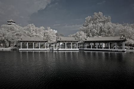 ir: infrared photo - lake, chinese house and tree in the parks