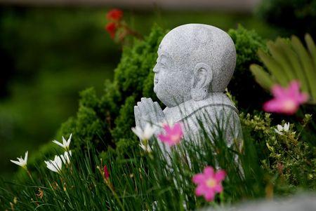 stone buddha: stone Buddha and flower in the gardens