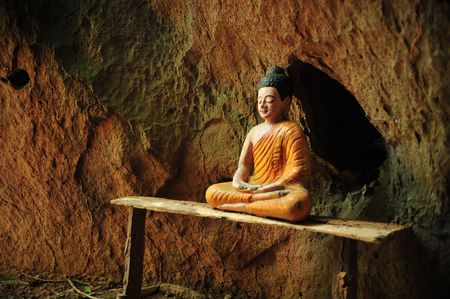 hideout: Buddha statue under the rock
