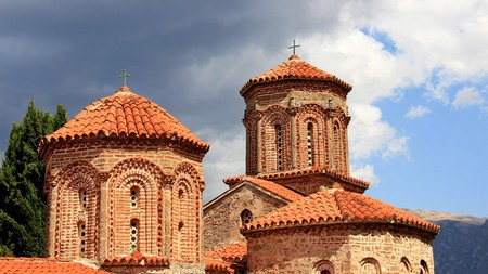 Old church cultural heritage with rain clouds in Macedonia Stock Photo