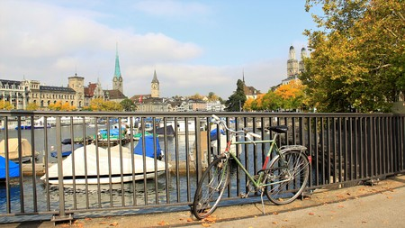 One bike by river side and autumn leaves with city view Editorial