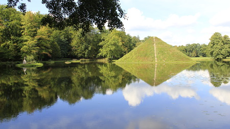 Green Park With Reflection Of  Pyramid Island In Cottbus Germany