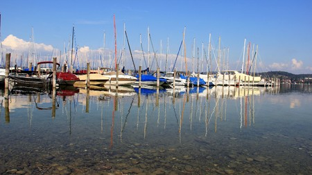 Small harbor with colorful and reflection of boat in Germany Editorial