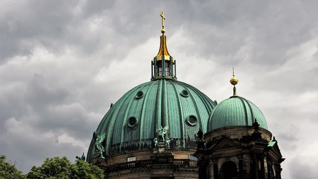 Berlin Dome With Golden Cross And Cloudy Sky Backgrounds Stock Photo
