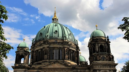 Close Up Of Berlin Cathedral Dome With Cloudy Sky In Summer Time. Berlin Germany Stock Photo