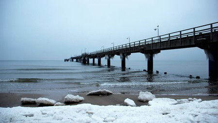 Baltic sea with long sea bridge in wintertime quiet pure murk weather on Usedom Island Germany Stock Photo
