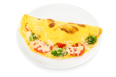 omelet: omelet with cheese broccoli and tomatoes on white
