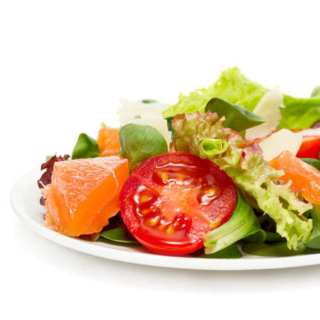 vegetable salad: vegetable salad with salmon and parmesan cheese isolated on white Stock Photo