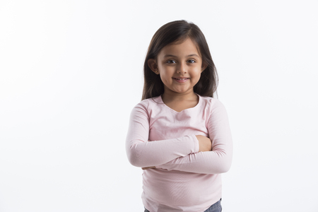 Portrait of a little girl standing with her arms crossed Banco de Imagens
