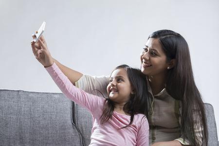 Mother and daughter taking selfie Banco de Imagens