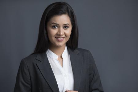 Portrait of smiling woman wearing black coat Banco de Imagens