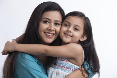 Happy mother and daughter hugging Standard-Bild