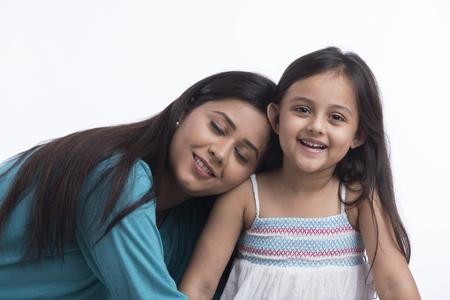Mother leaning on daughter shoulder