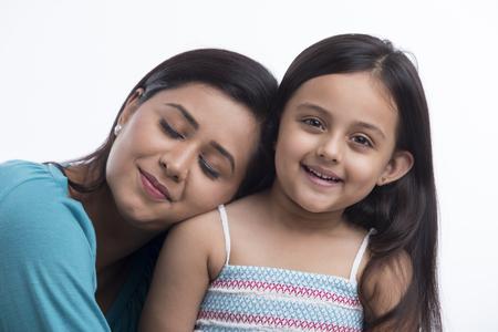Portrait of mother leaning on daughter shoulder`