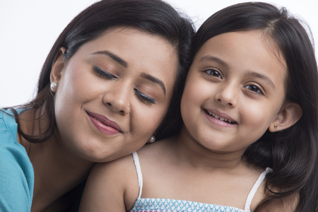 Close up of mother leaning on daughter shoulder