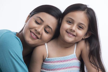 Portrait of smiling mother leaning on daughter shoulder Banco de Imagens