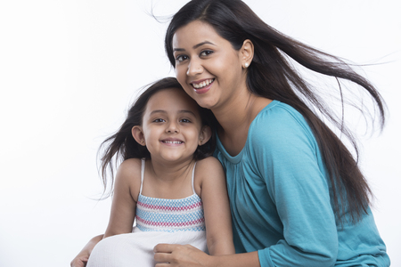 Portrait of smiling daughter and mother