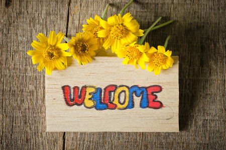 welcome label with yellow flower photo
