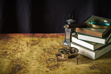 Koran - holy book of Muslims with lantern and Magnifier on the old map  photo