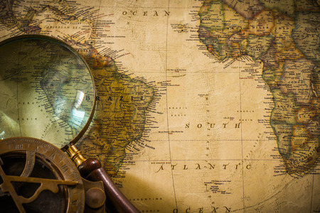 tool transparent white world: old map with compass and Magnifier Stock Photo