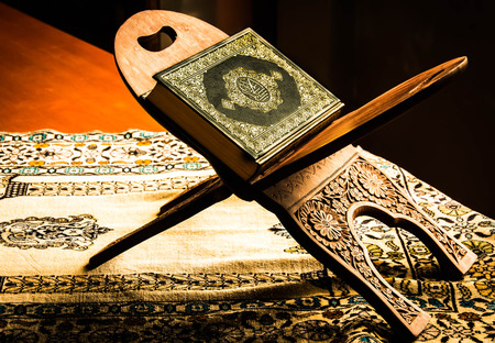 learning pray: Koran - holy book of Muslims