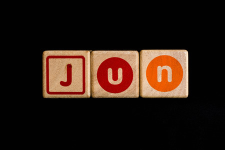 cubic: june on wood Cubic on black background