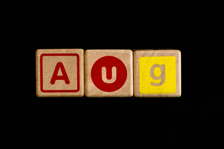 cubic: August on wood Cubic on black background