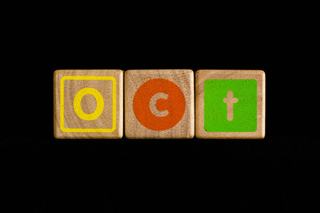 cubic: October on wood Cubic on black background