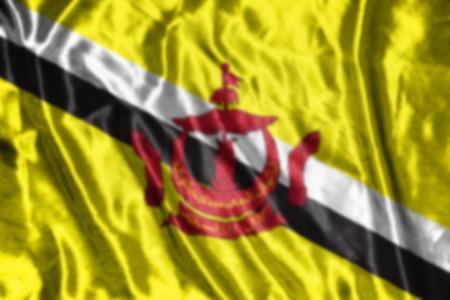 brunei darussalam: Brunei Darussalam flag,abstract blurred background Stock Photo