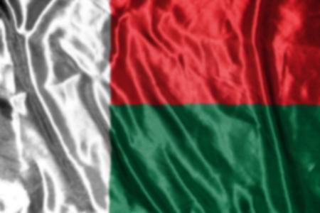 madagascar: madagascar flag,abstract blurred background Stock Photo