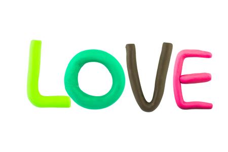 plasticine: LOVE,clay on white background