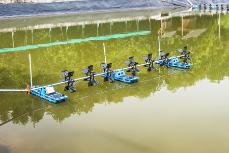 aeration: Aeration machine working in the water. Stock Photo