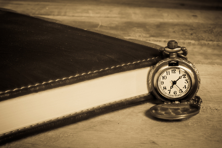 history background: pocket watch,vintage style filtered photo