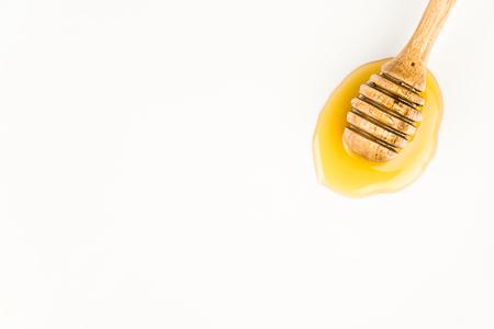 dipper: wooden honey dipper on white background