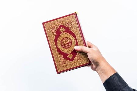 namaz: Koran in hand ,Quran in hand  - holy book of Muslims , on white background