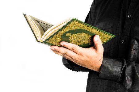 koran: Muslim Man holding the Koran Stock Photo