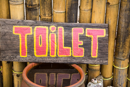 old sign: old toilet sign , wood