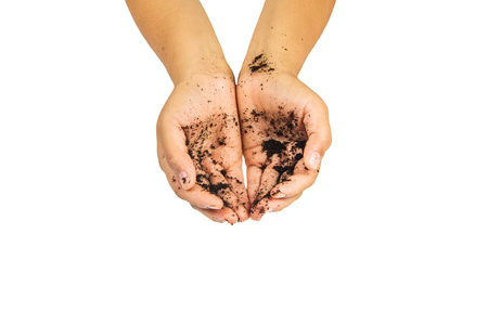 soil treatment  in hands on white background. Stock Photo
