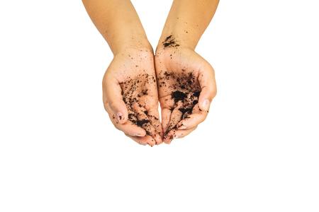 fertile: soil treatment  in hands on white background. Stock Photo
