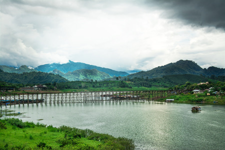 landscape of Wooded bridge over the river (Mon Bridge) in Sangkhlaburi District, Kanchanaburi, Thailand