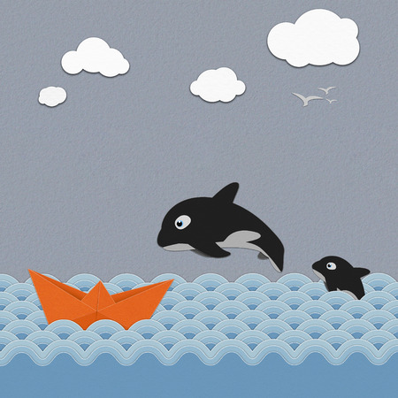 Origami boat  and  Orcinus orca  on the  sea ,paper art