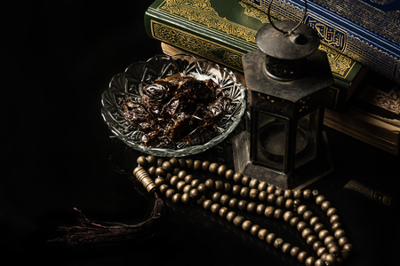 prayer beads  with date palm on black background
