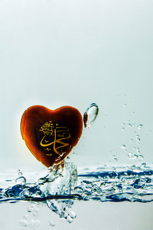 muhammad  prophet of Islam ( symbol ) Water splash with bubbles of air, isolated on the white background Stock Photo