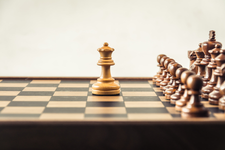 Chess on board white backgroung. Confrontation concept